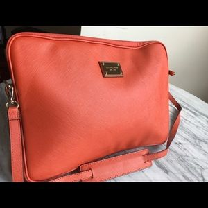 Michael Kors leather laptop bag with strap